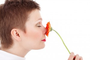 woman-smelling-flower